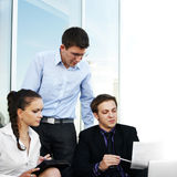 Three young businessperson are working together Royalty Free Stock Image