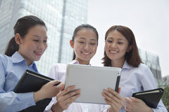 Three young businesswomen discussing outdoors Stock Photo