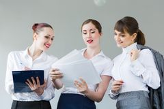 Three young businesswomen Stock Images