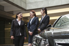 Three young businesswomen meeting and talking in parking garage Stock Images