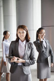 Three young businesswomen outside, portrait Stock Images