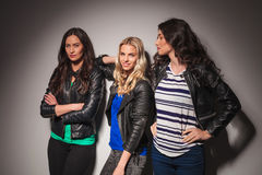 Three young casual women in leather jackets Stock Images