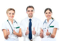 Three young Caucasian doctors in white clothes Royalty Free Stock Image
