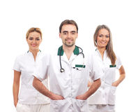 Three young Caucasian doctors in white clothes Stock Photo