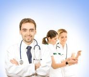 Three young Caucasian doctors in white clothes Royalty Free Stock Images