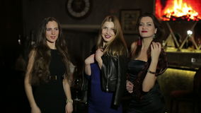 Three young caucasian female send a kiss to the camera in luxury bar stock video footage