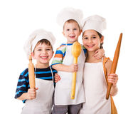 Three young chefs with ladle and rolling pin Royalty Free Stock Photo