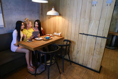 Three young cute girl girlfriends chatter, gossiping, share secr Stock Photo