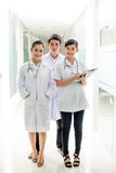 Three young doctors Stock Photos