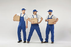 Three young empyees with the boxes Royalty Free Stock Images
