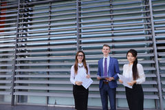 Three young entrepreneur modern, educated students, guy and two Royalty Free Stock Image