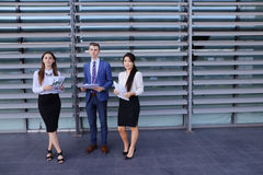 Three young entrepreneur modern, educated students, guy and two Royalty Free Stock Photography