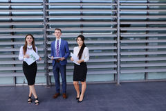 Three young entrepreneur modern, educated students, guy and two Stock Photography