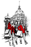 Three young fashionable women shopping in Paris Royalty Free Stock Image