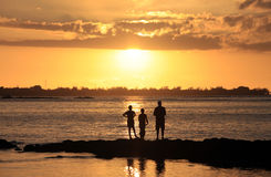 Three young fishermen Royalty Free Stock Image