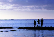 Three young fishermen Royalty Free Stock Photography
