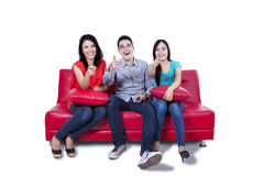 Three young friends pointing at the camera Royalty Free Stock Photos