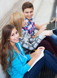 Three young friends sitting together. Portrait of young people smiling Royalty Free Stock Photo