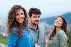 Three young friends standing together Stock Photography
