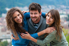 Three young friends standing together Royalty Free Stock Images