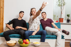 Three young friends taking a selfie Royalty Free Stock Photos