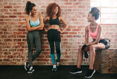 Three young friends talking after fitness training Stock Photo