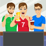Three young friends watching sports game Royalty Free Stock Photos