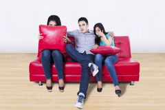 Three young friends watching TV Royalty Free Stock Image