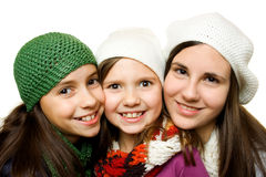 Three young girls. In winter outfit isolated on white Stock Image