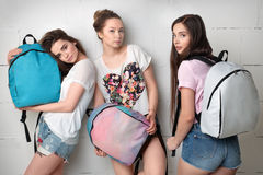 Three young girls with backpacks Royalty Free Stock Image