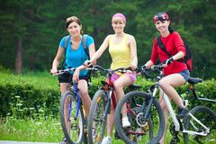 Three  young girls on bicycle Royalty Free Stock Photo