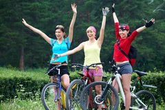 Three  young girls on bicycle Royalty Free Stock Images