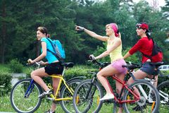 Three  young girls on bicycle Stock Image