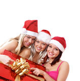Three young girls celebrate Christmas Stock Photos