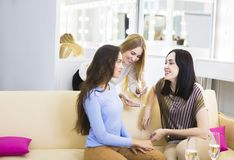Three young girls celebrating with champagne Stock Photography