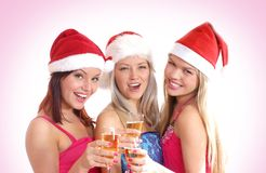Three young girls are celebrating Christmas Stock Images