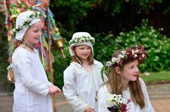 Three young girls in costume enjoying May day reenactment Royalty Free Stock Photos