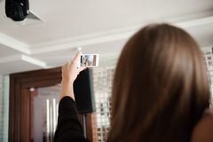 Three young girls are doing selfie photo in a restaurant. stock image