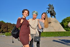 Three young girls are doing the song Heart in St. Petersburg royalty free stock image
