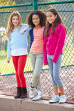 Three Young Girls Hanging Out Together In Park Stock Image