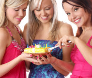 Three young girls are having a birthday party Stock Images