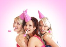 Three young girls are having a birthday party Royalty Free Stock Photography