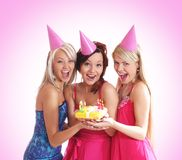 Three young girls are having a birthday party Stock Image