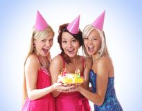 Three young girls are having a birthday party Royalty Free Stock Images