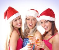 Three young girls are having a Christmas party Royalty Free Stock Images