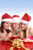Three young girls are having a Christmas party Royalty Free Stock Photo