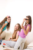 Three young girls laughing and having fun Royalty Free Stock Images