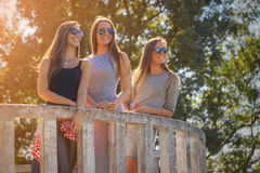 Three young girls laughing and having fun outdoors Stock Images