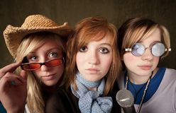 Three Young Girls with Microphone Stock Image