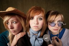 Three Young Girls with Microphone Royalty Free Stock Images